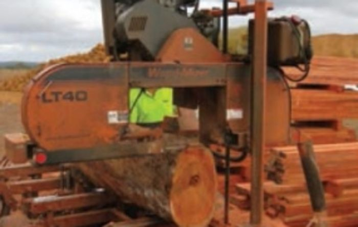 Harvesting farm timber with a portable saw mill