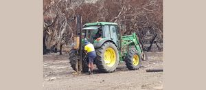 Volunteer farmers help with bushfire rebuild