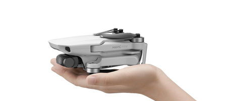 Mavic mini palm-sized drone takes off